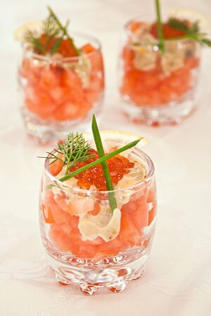 red caviar and salmon in glass photo
