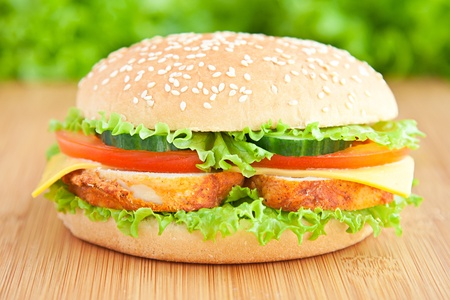 eating chicken: hamburger with chicken and vegetables Stock Photo