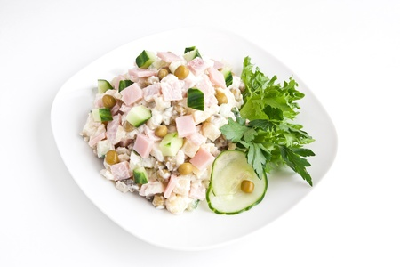 plate with russian salad olivie Stock Photo