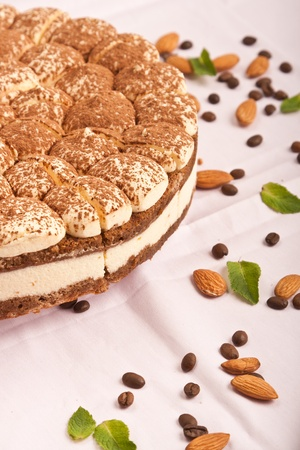 sweet tiramisu cake with almonds and coffee beans