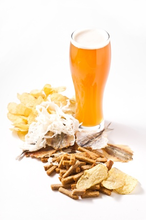 light beer in glass with any snack