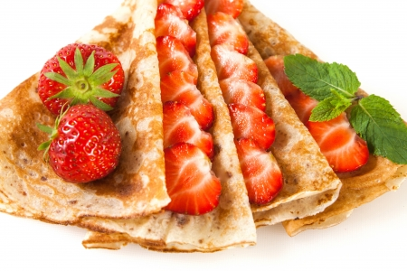 Rolled thin pancakes with strawberry and mint Stock Photo