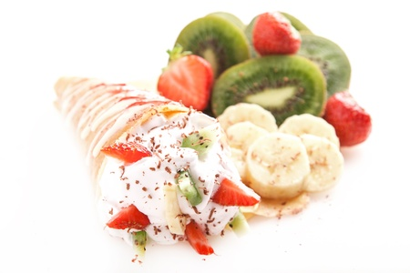 Rolled thin pancakes with sweet cream and fruits