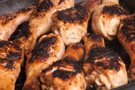 some juicy roast chicken drumstick on frying pan Stock Photo