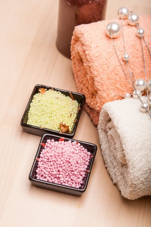 orange washcloth: colored sea salt and towels for spa relax