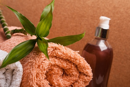 orange washcloth: gel and towels for spa relax Stock Photo