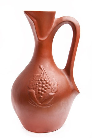 traditional clay jug for wine on white background Stock Photo