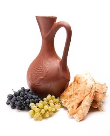 traditional clay jug for wine with grapes and lavash Stock Photo