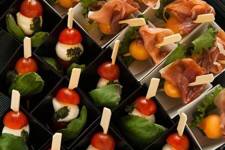 different snack on skewer in mini box for party Stock Photo