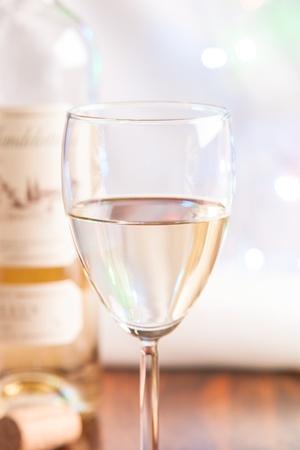 blink: glass and bottle white wine on blink light background