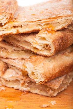 piece of slice thin sweet pie on wooden board Stock Photo - 17316369