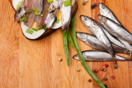 sandwich from salted anchovies with egg and spring onion on wood Stock Photo - 17726062