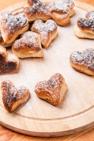 bakery hearts from split pastry with sugar powder on wooden board Stock Photo - 17855246