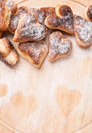 bakery hearts from split pastry with sugar powder on wooden board Stock Photo - 17855235
