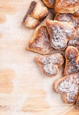 bakery hearts from split pastry with sugar powder on wooden board Stock Photo - 17855242