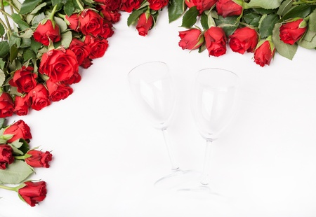 background with red roses and wine glass on white