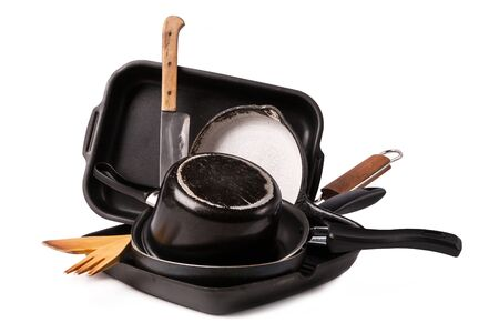 heap of kitchen bakeware with pans and pot Stock Photo