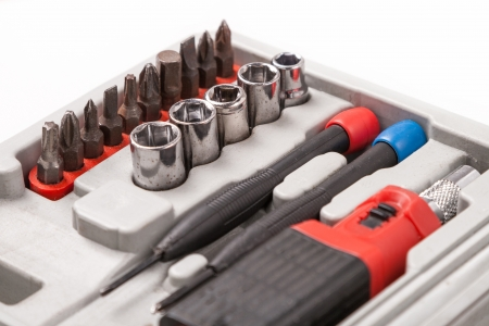 open toolbox with screwdriver, heads and bits photo