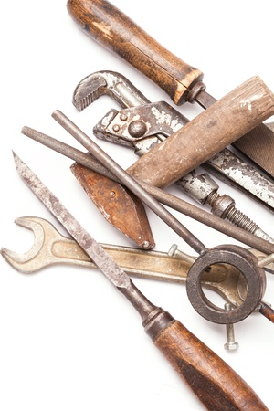 old metal work hand tools with rust on white background photo