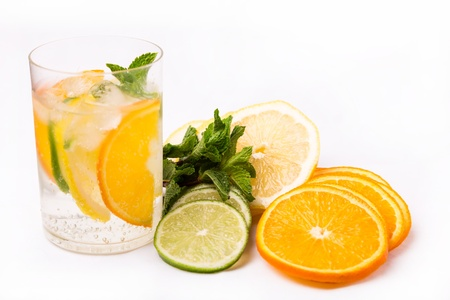 fresh cold cocktail in glass with sliced cituses Stock Photo - 20377810