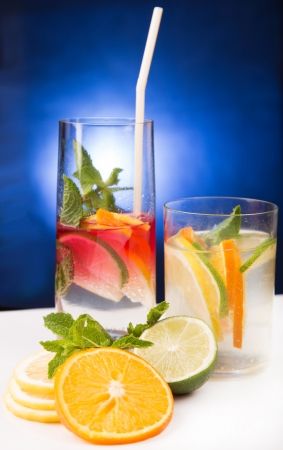 fresh cold cocktail in glass with sliced cituses Stock Photo - 20377812