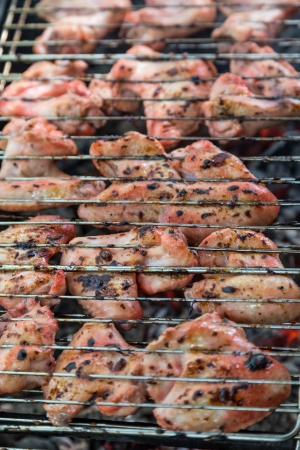 juice marinated chicken wings in grilled barbecue photo