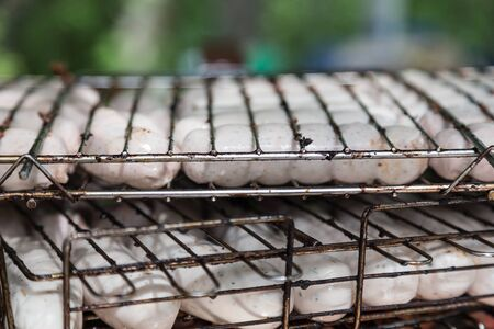 many uncooking sausages for grilled barbecue photo
