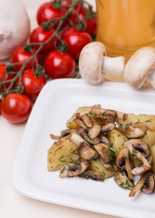 hot potato and mushrooms with garnish on white plate photo