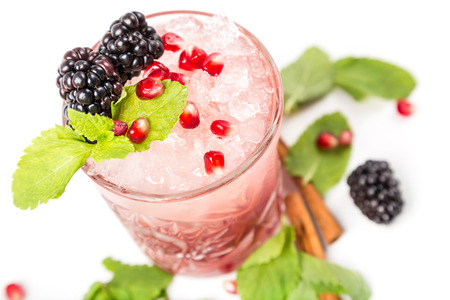 coctail with ice, berrys and leaf mint