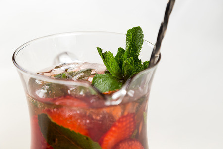 metall and glass: head of jag with fresh cold lemonade from strawberries Stock Photo