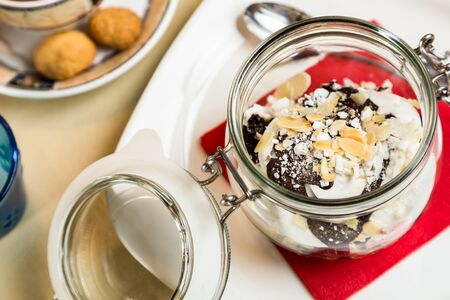 metall and glass: sweet dessert in glass jar on table