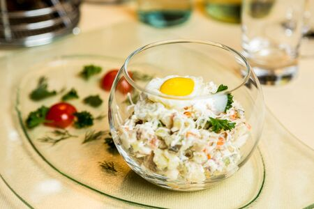 metall and glass: Restourant serving dish - salad in glass on table