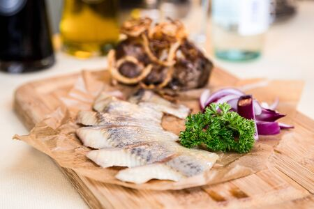 metall and glass: Restourant serving dish - pieces herring for snack
