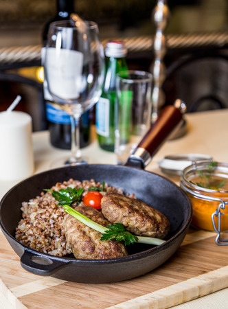 metall and glass: Restourant serving dish - cutlet with buckwheat on wooden board