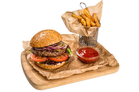 metall and glass: burger with meat, frying potato on wooden board