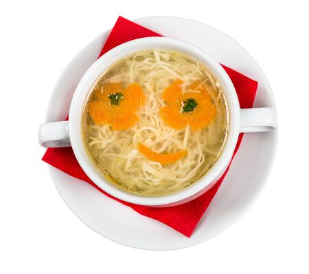 Restourant serving dish for child`s menu - noodles soup with face on white background photo