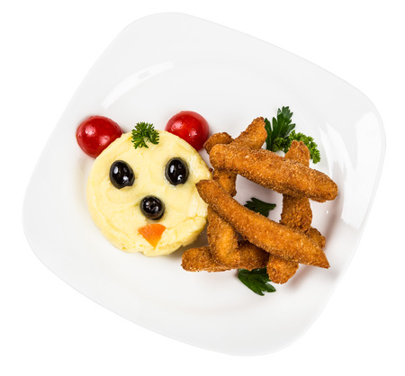 metall and glass: Restourant serving dish for child`s menu - potato puree, sticks with face on white background Stock Photo