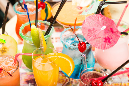 different freshness cocktails with ice in glasses with drinking straw and umbrellas Stock Photo