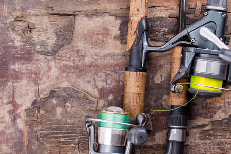 tackle: fishing rod and reel with line on natural background for frame, print, design Stock Photo
