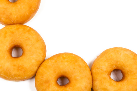 portly: fried equal round doughnuts in frame on white background