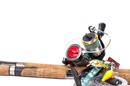 tackles: fishing tackles rods, reels, line and lures on white background