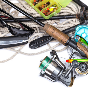 tackles: fishing tackles and anchor with cord on white background