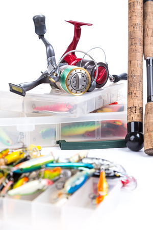 overthrow: fishing tackles, fishing lure and fishing bait on plastic storage boxes on bright white background. for design advertising or publication Stock Photo