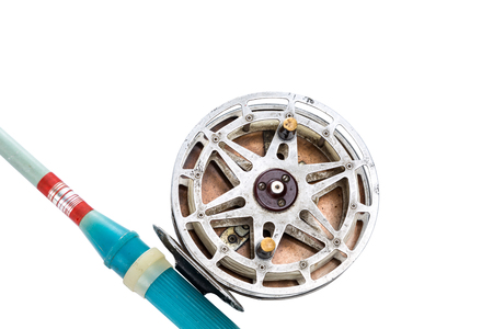 fishing reel: vintage fishing reel and rod on white background