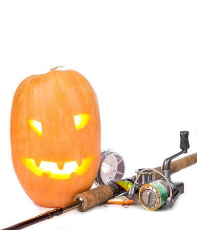 tackles: halloween pumpkin head with fishing tackles on white background Stock Photo