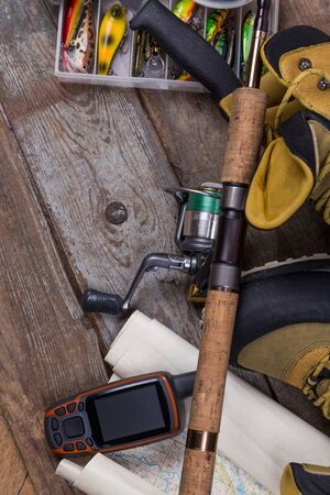 intend: fishing tackles and fishing gear on tinber boards
