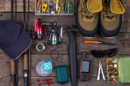 fishing tackles and fishing gear on tinber boards look on top Stock Photo