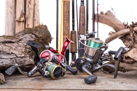 snag: fishing reels and fishing rods with wooden board and snag