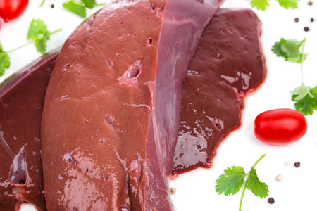side of beef: piece raw liver a beef from on side on white background. for advertising, promo, banner or print