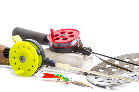 fishing reel: closeup ice fishing tackles with jig, line, rod Stock Photo